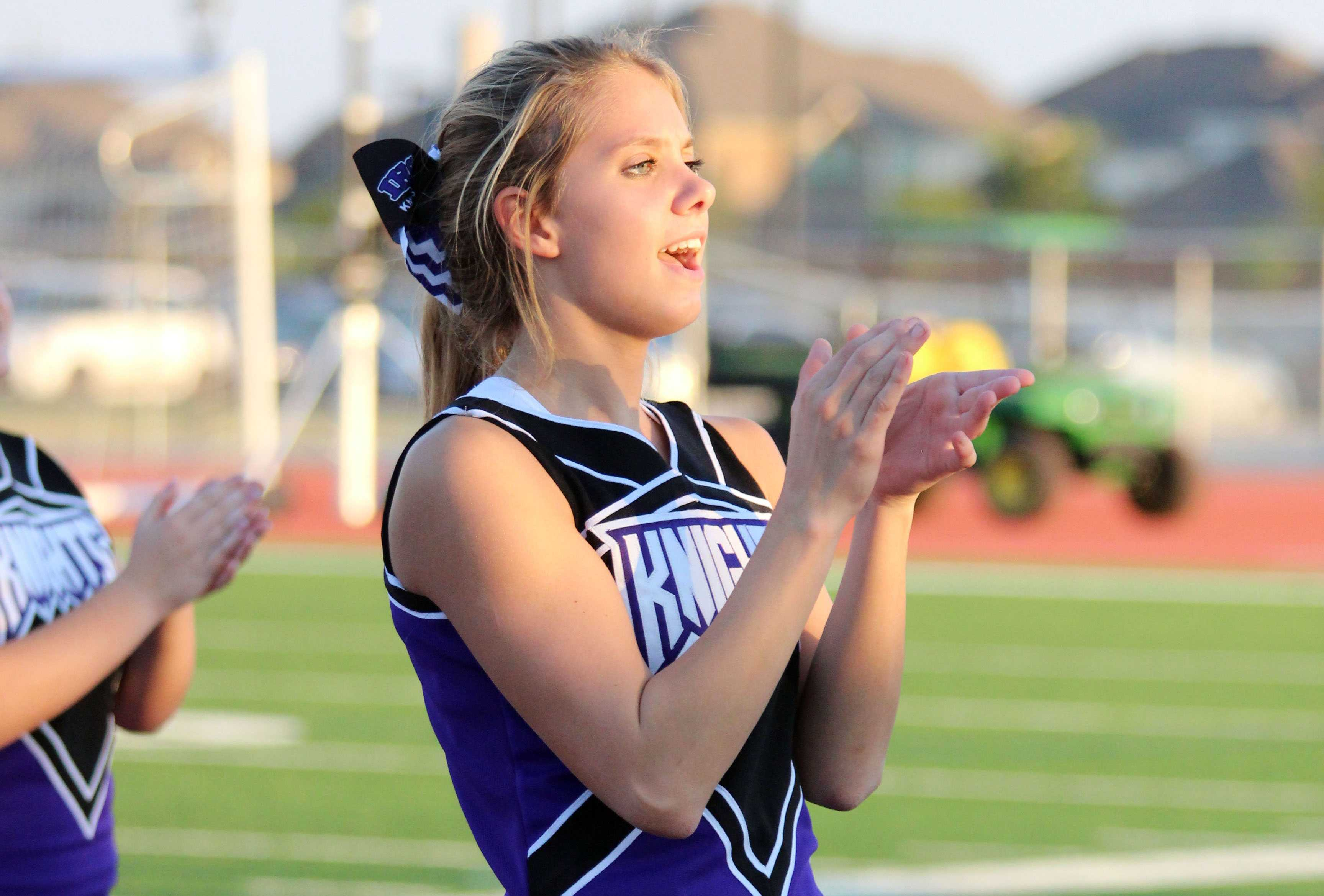 Peyton Harris shows her school spirit as co-captain of the cheerleading squad.