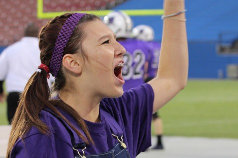 Sophomore Taylor Lenard yells at a home football game.