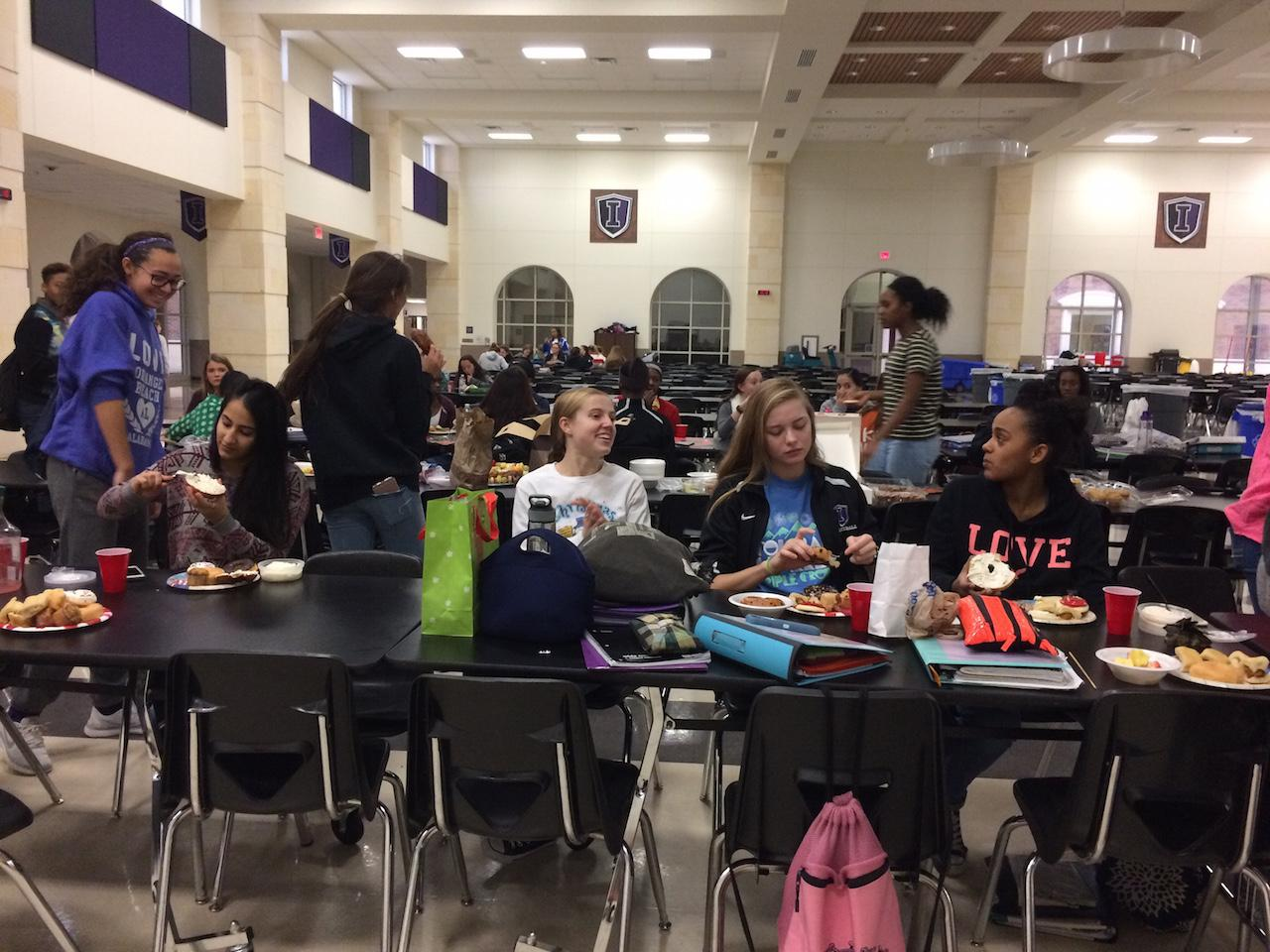 These varsity basketball players bond and connect over a breakfast social.