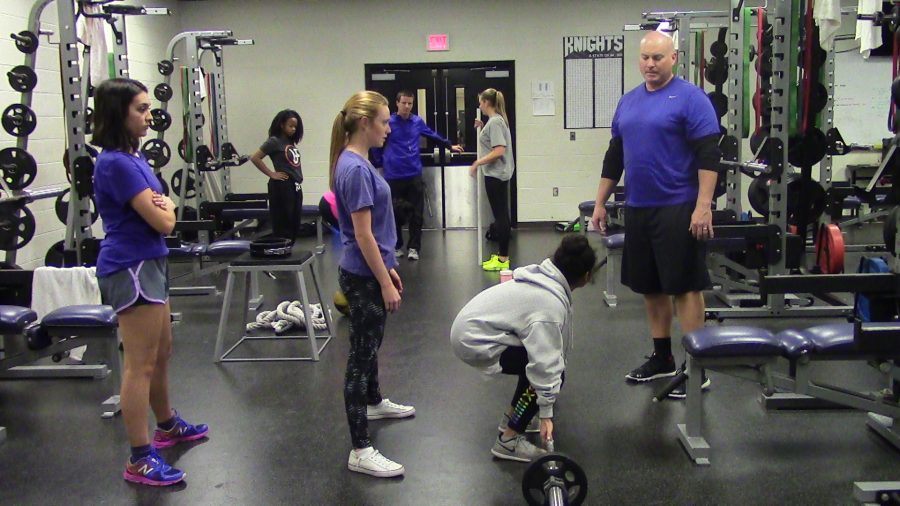 Coach+Walker+checks+if+the+female+powerlifters+are+using+proper+lifting+techniques.+He+does+this+to+make+sure+they%E2%80%99ll+be+ready+for+any+co-ed+competitions%2C+meets+or+even+practices.+