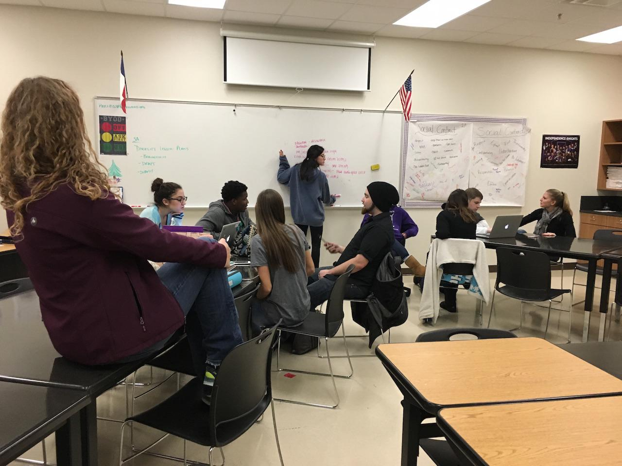 Student Ambassadors work on one of their upcoming presentations to show during activity period. While doing this they're discussing issues and what they feel is important to put in it.