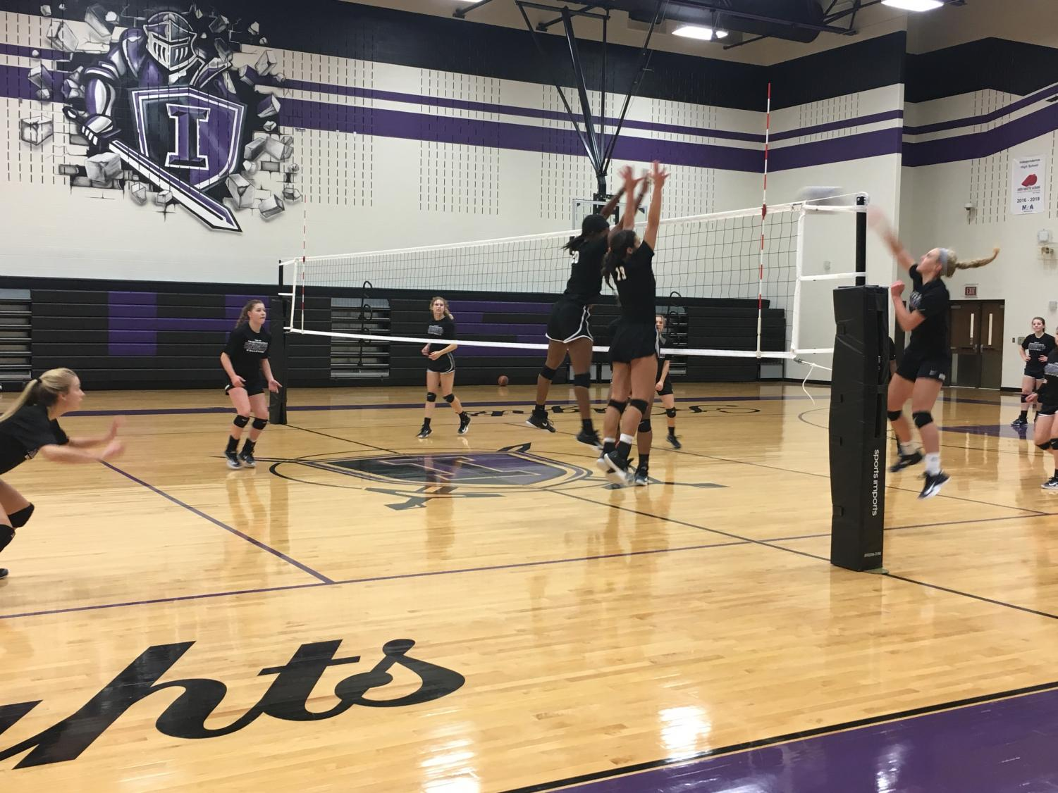 The Varsity Volleyball team is using  the new techniques that Coach Haller has brought, including the 'one percent strategy.'