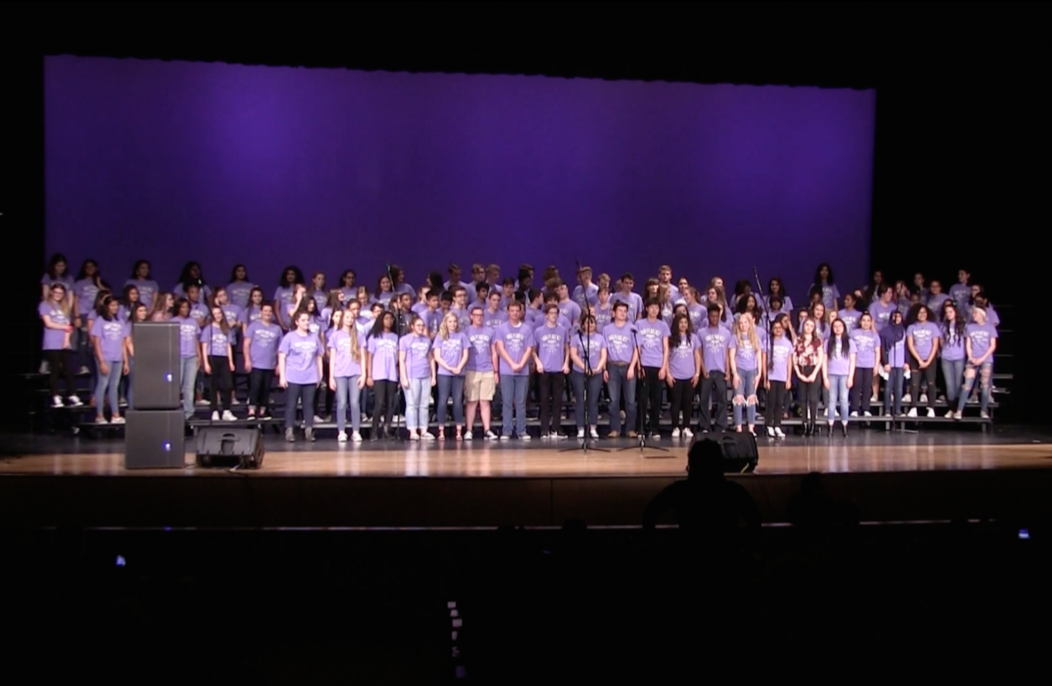 "All of the choir members come together for the last time to sing ""Send It On"" to close out their final concert of the year."