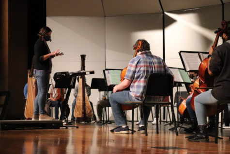Orchestra Director Lindsey Titus instructs her students though a piece of music.