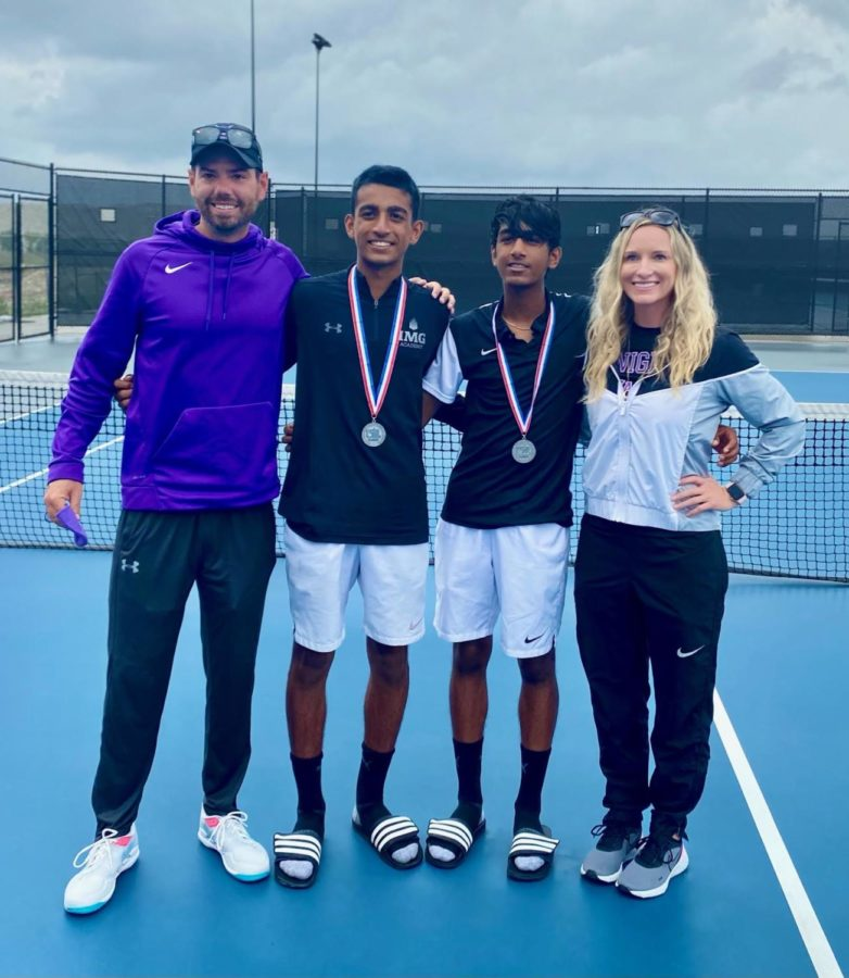 Coaches Jennifer Paine and Daniel Olivares stand alongside the boys doubles state qualifiers.