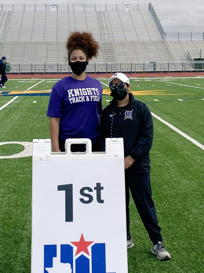 Alauna Richardson stands by Coach Yeatman after winning first place at regionals for discus on Friday, April 23, 2021. (Knight Press/Alauna Richardson's Twitter)