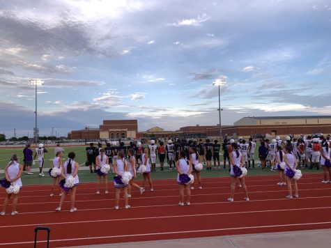 IHS cheerleaders stand-by ready to cheer on the varsity football scrimmage game on Saturday, August 16 at the annual Rumble celebration.